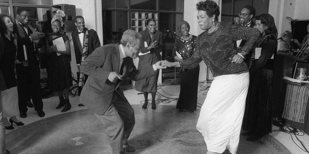 Amiri Baraka and Maya Angelou dance at the The Schomburg Center for Research in Black Culture in New York.